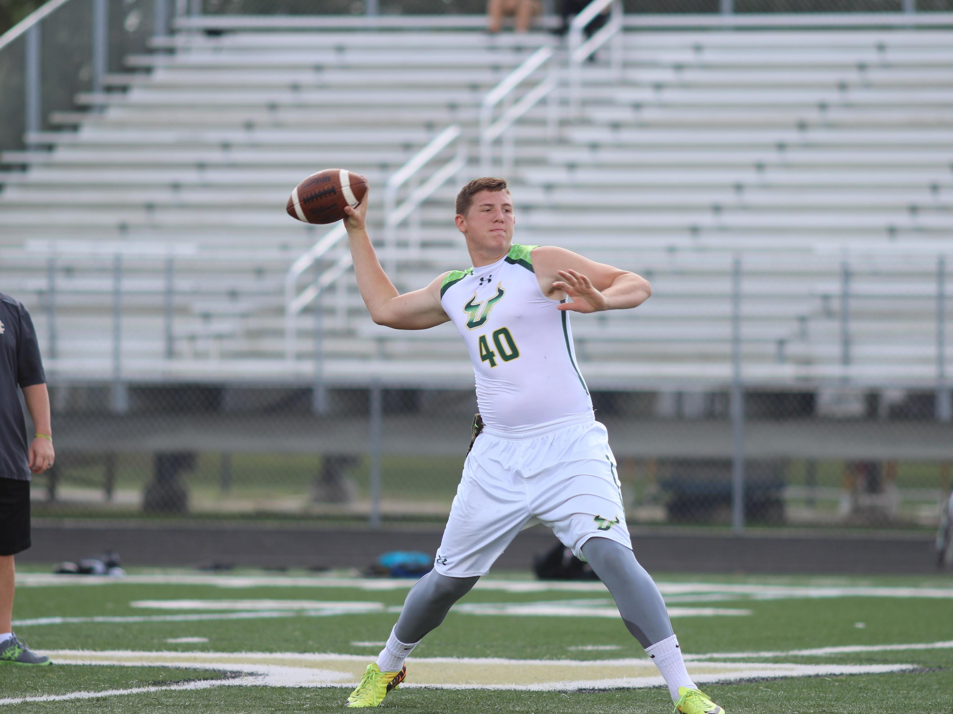Island Coast quarterback Kory Curtis prepares to throw a pass during a 7-on-7 game at Golden Gate High School.