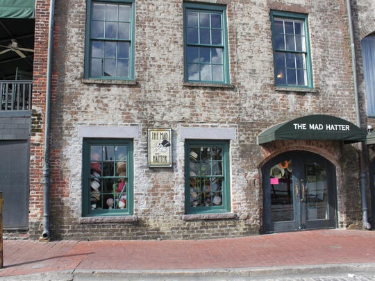 Historic building on River Street is shown.