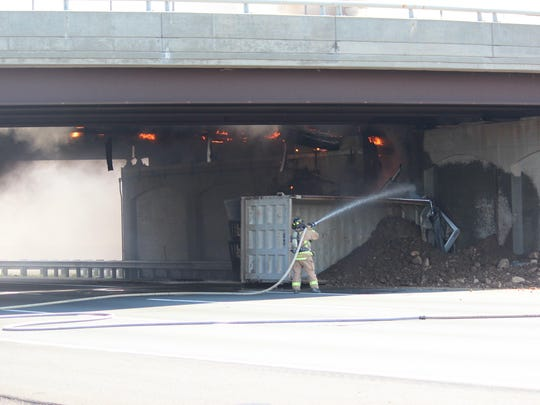 An overturned dump truck on Tuesday on the New Jersey Turnpike in Linden.