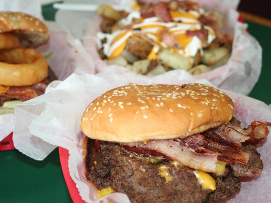 Cereal City Burgers features such items at the double-bacon cheeseburger, the cowboy burger and loaded potatoes.