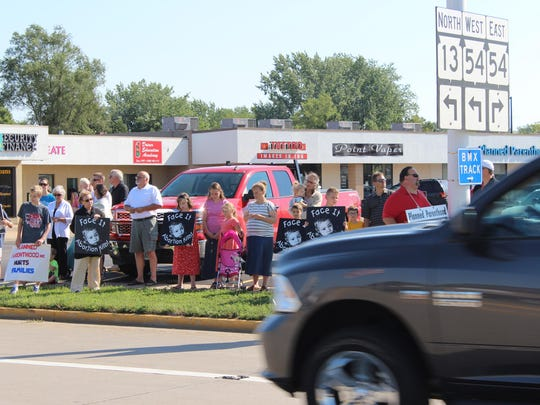 Demonstrators recite the Catholic rosary and prayers while lined along South Eighth Street in Wisconsin Rapids to protest the city's Planned Parenthood clinic on Aug. 22.
