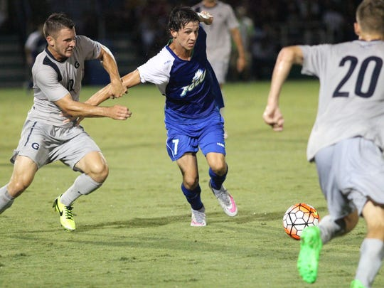 FGCU's Dennis Zapata attempts to keep possession of the ball during Friday night's home opener against No. 3 Georgetown.