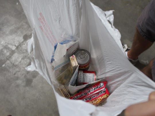 A plastic bag filled with enough food for 6 small meals for children facing hunger issues in their home after school.