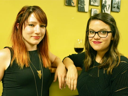 """Emily Lullo Echevarria and Kirstin Cassandra Norris """"make time for the things that are important"""" at the Feminist Society of Pensacola's August meeting downtown."""