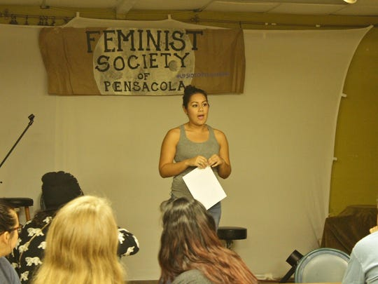 Therapist and victim's advocate Maria Paoli, M.A. speaks to Pensacola Feminist Society meeting attendees during the monthly meeting downtown at Sluggos's Vegetarian Restaurant.