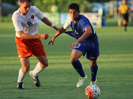 FGCU forward Miguel Jaime fights for possession with a Princeton defender during Thursday night's game against the Tigers.
