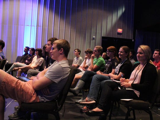 Students listen to the story of David and Goliath at