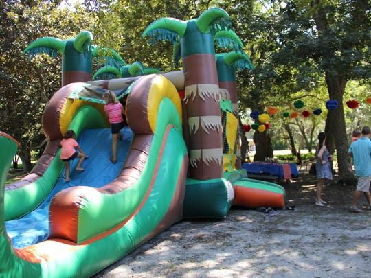 A bouncy house such as this one from Sunny Days Bounce House Rentals is a hit at any kid's birthday party.
