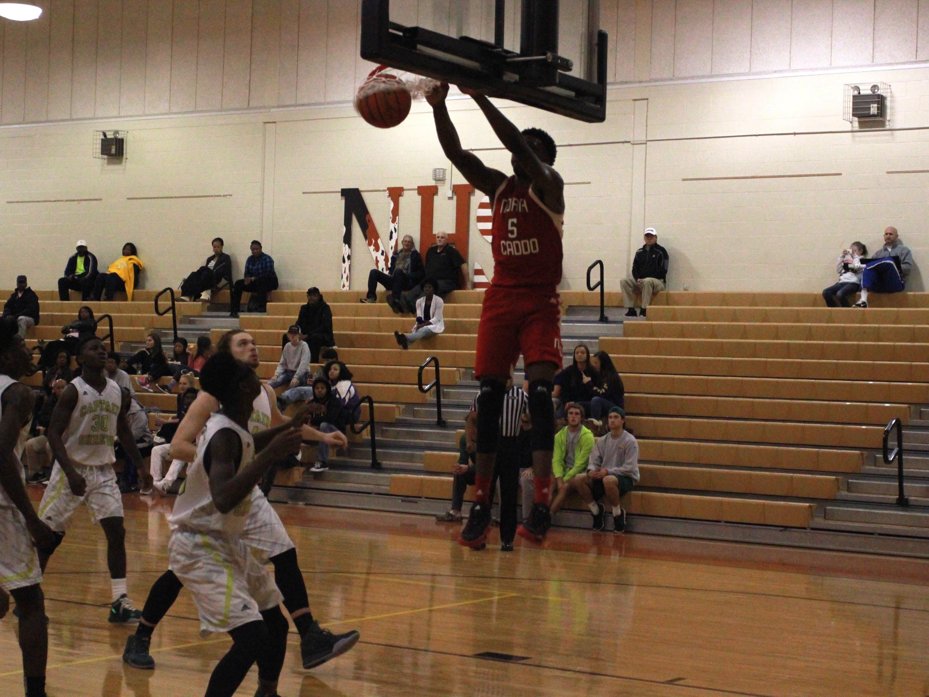 Robert Williams(5) slam dunks two points in for North Caddo against Captain Shreve Thursday night at Northwood High School in Blanchard.