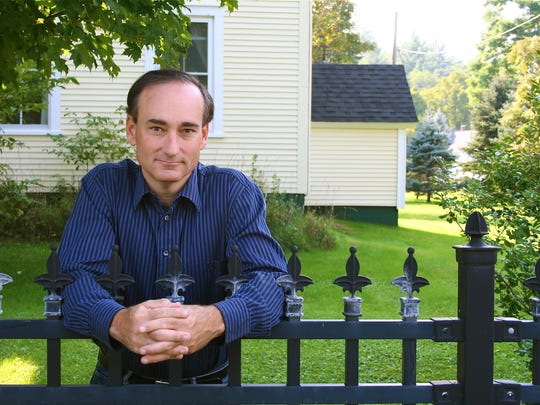 Author Chris Bohjalian outside his home in Lincoln.