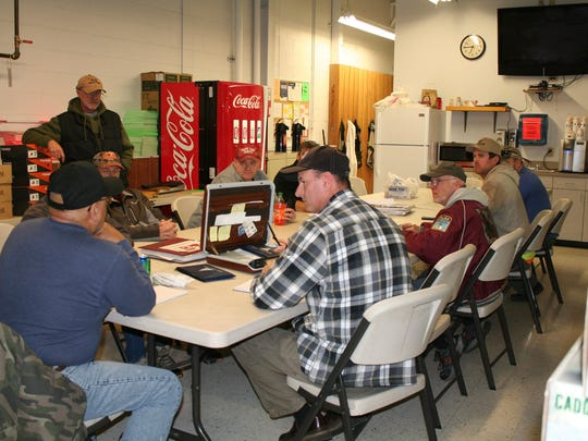 Members discuss the upcoming bass fishing tournaments during the Central Valley Bass Club monthly meeting on January 5.
