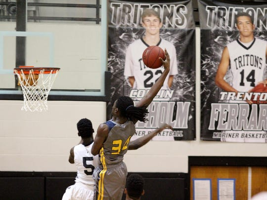 Deijuan Thomas throws down a monster dunk during the first quarter of Saturday's game between Mariner and Lehigh.