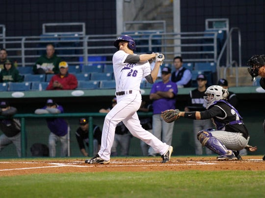 Florida SouthWestern's Enrique Ferrer hits the ball during the school's first baseball game against ASA College of Miami on Friday night at City of Palms Park.