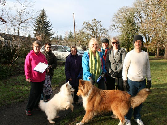 Ann Scheppke, left, Sharon Brown with her dog Wiley, Beth Anne Huffine, Christie O'Brien with her dog, Bob, Jaylene Cobb, Susan Tanabe, and Patrick Cassidy gather Jan. 18 for the Just Walk Salem walk in Bush's Pasture Park.