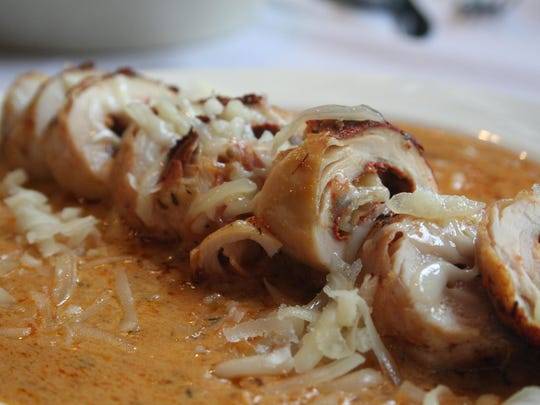 Pollo relleno is a tapas calientes, a rolled stuffed chicken breast.
