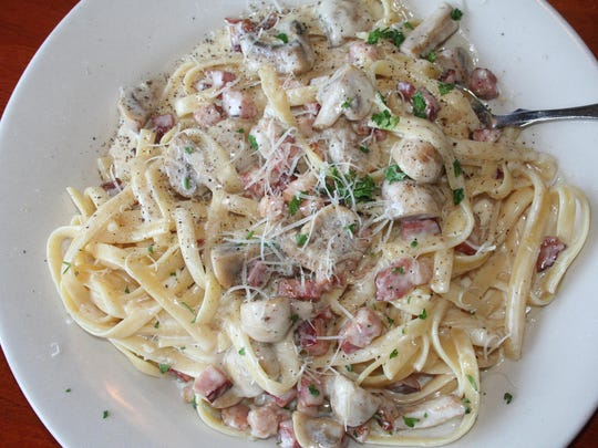 Canal Street's Carbonara at Canal Street Cafe in Augusta, featuring house cured pork belly, mushrooms and fettuccine.