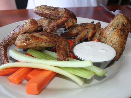 Smoked Otto's wings, with a Jamaican jerked seasoning at Canal Street Cafe in Augusta.
