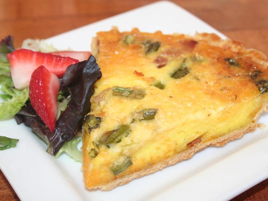 Quiche featuring asparagus, cheddar cheese and ham