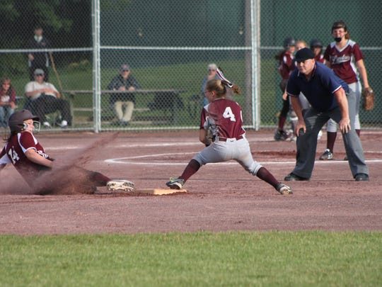 Mount Abraham's Emily Aldrich slides into second base as Lyndon's Niah Colby looks to apply the tag during Friday's Division II high school softball state championship game in Poultney.