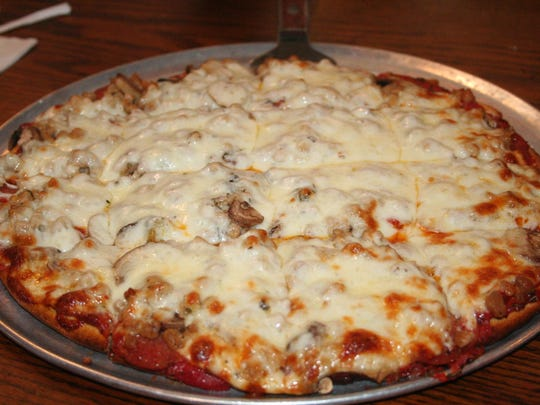 The 'House Pizza' at Cascarelli's as the classic trio of pepperoni, sausage and mushroom.
