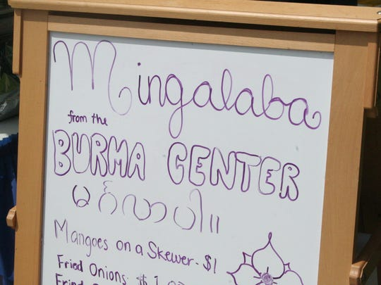 The Burma Center was offering spicy mango on a stick at International Festival.