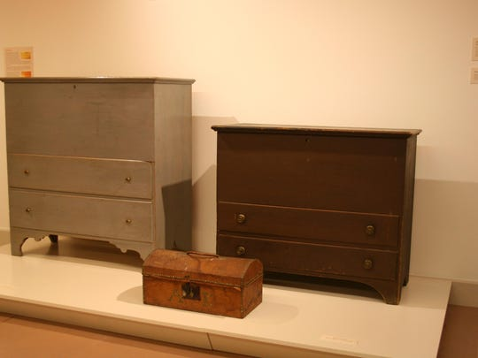 Stephen Foster Stevens made the gray-painted blanket chest, left, for Ann King, who was part of the Robinson household at Rokeby. She also purchased the small leather-covered trunk, which has her initials spelled out in brass tacks.