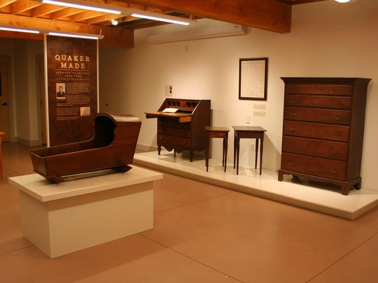 The Robinson's cradle is in the foreground. Stevens made the slant-top desk in 1820, while still and apprentice.