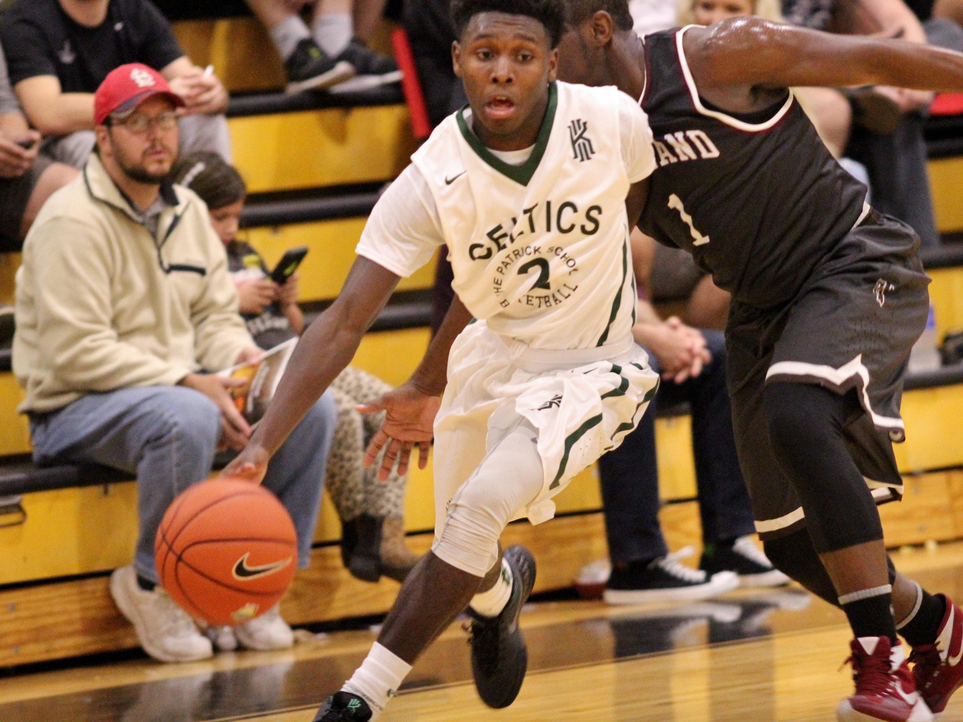 Jordan Walker of Elizabeth (New Jersey) Patrick School dribbles past Miami Norland's Kennith Rolle in the 2015 City of Palms Classic