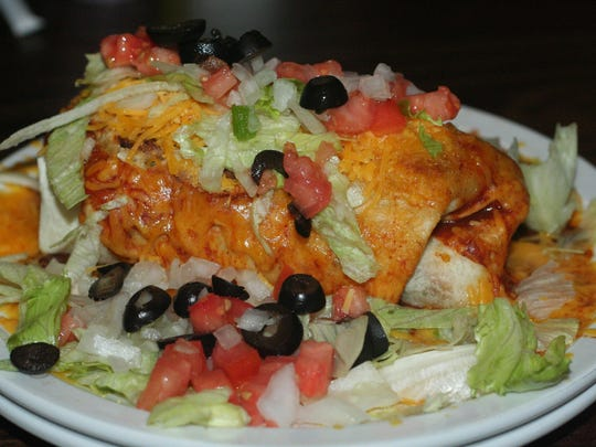 On the Bill's Bites College Tour, the wet burrito is one of the specialty items at the Lamplighter OC near the campus of Olivet College.