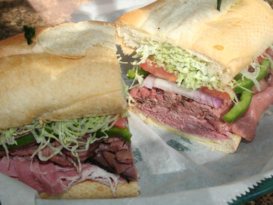 Bill's Bites College Tour continued at University of Michigan with a visit to Maize and Blue Delicatessen to try the Rose Bowl Treaty sub.