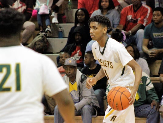 Rayville sophomore guard Mylik Wilson (1) looks over to his teammate Sadee W