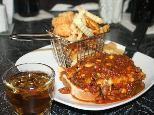 JB's Whiskey Creek Infirmary burger is an open-faced sandwich with sriracha jack cheese and cactus chili, which comes with the house specialty Hodge Podge fries.