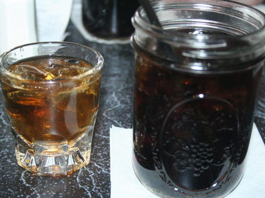 A feature of JB's Whiskey Creek is its menu of whiskey options from places around the state and the country. Black Swamp Cinnamon Spiced Whiskey is on the left and cola is in the jar on the right.