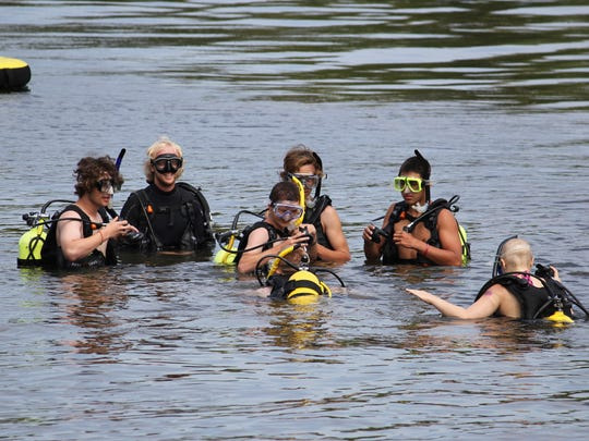 Campers explore the water at Camp Ta-Kum-Ta