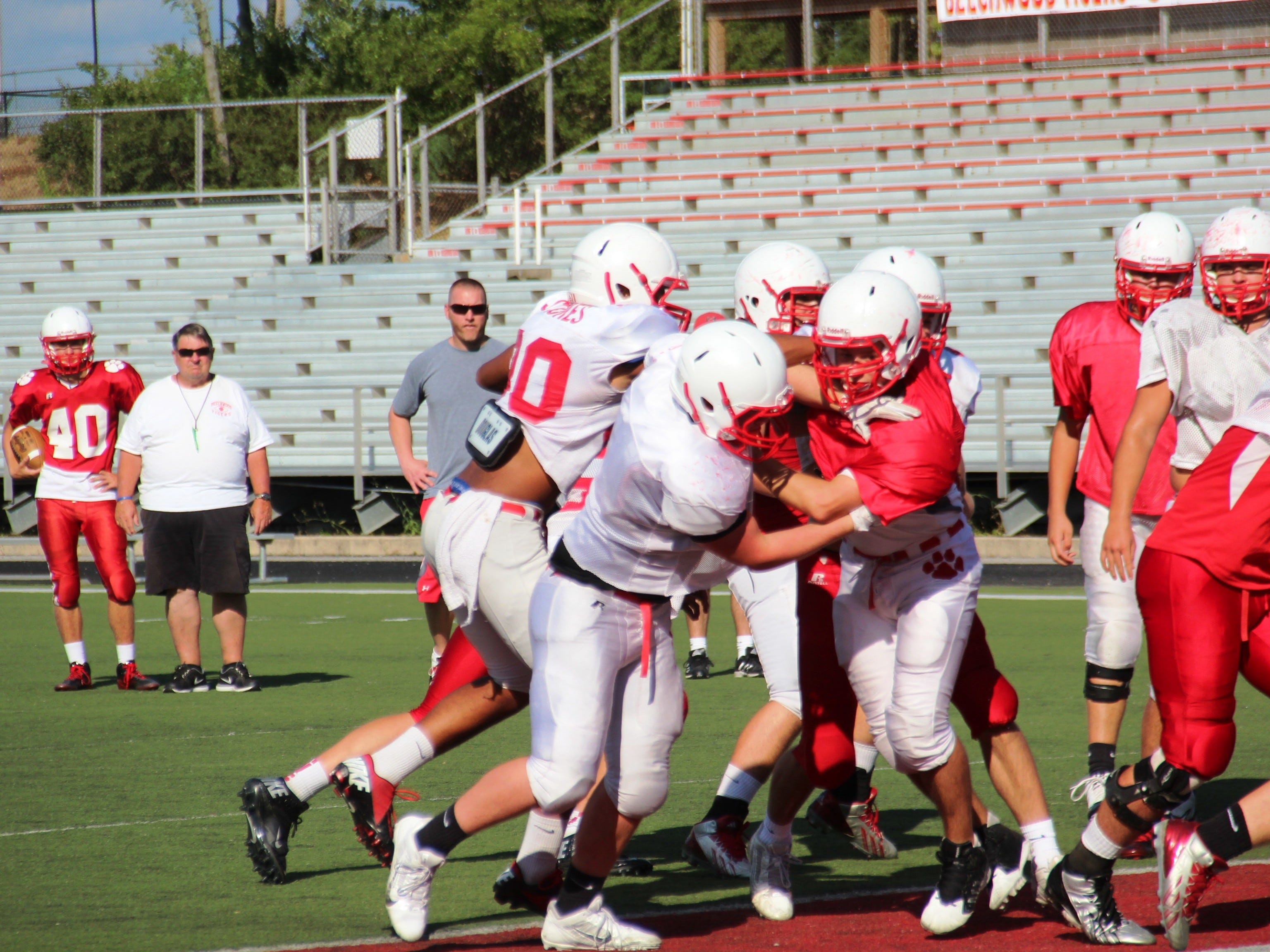 The Beechwood Tigers football team runs a play in practice.