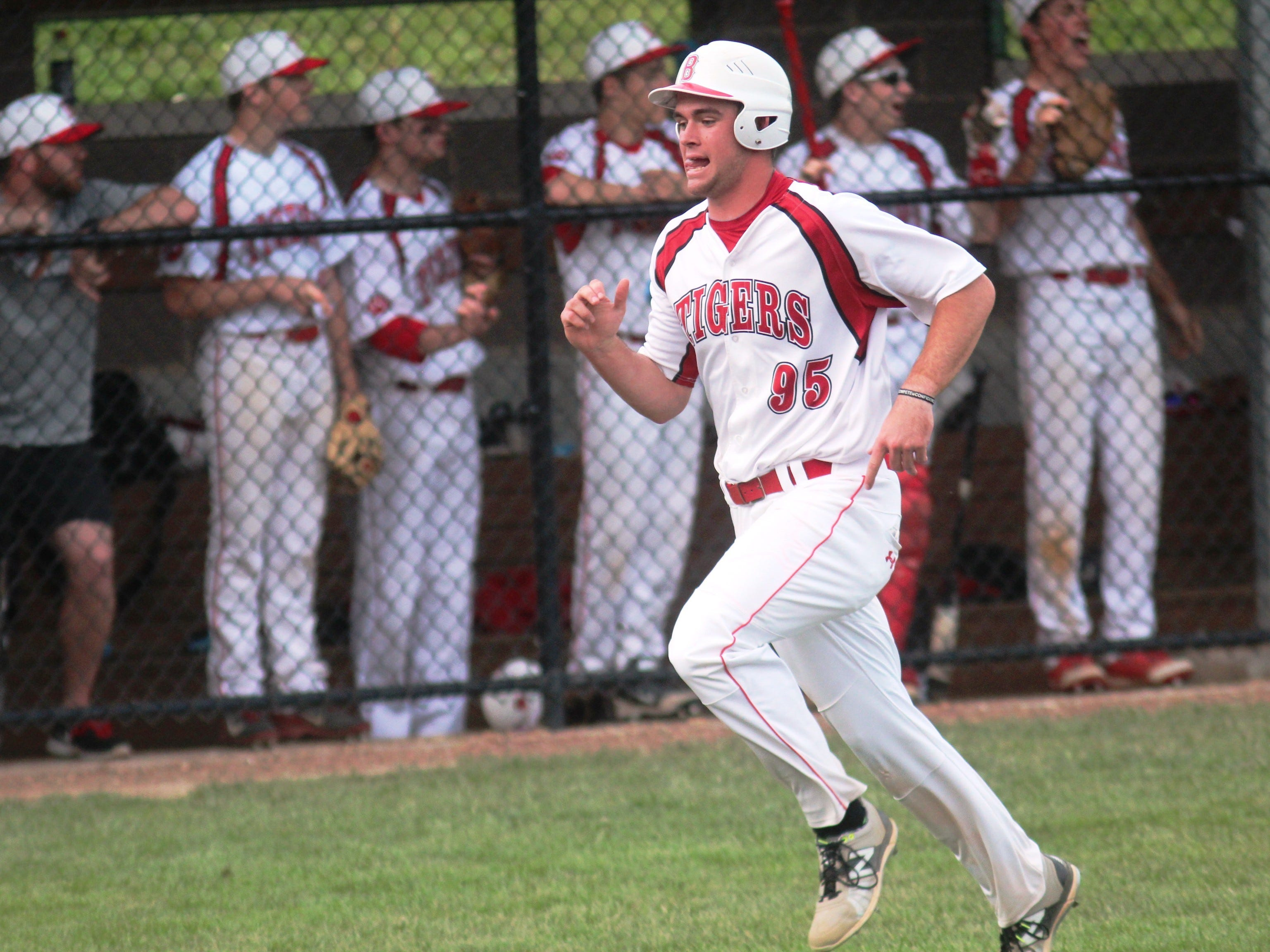 Beechwood junior Brayden Combs scores a run in the April 17 Doc Morris Invitational game against Moeller.