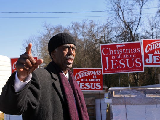 Pastor Jimmy Terry of Tabernacle Baptist Church is placing 10,000 Christmas signs in Clarksville yards.