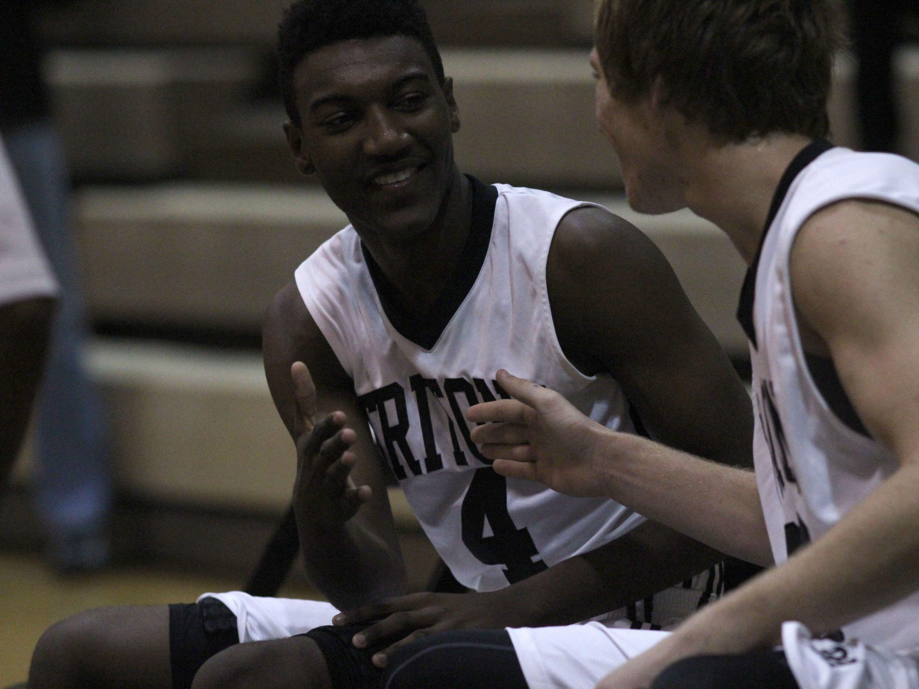 Mariner's Rodney Hunter does a handshake with teammate, Devin Deems, during the pregame introductions at the Tritons' game against Cypress Lake Friday night.
