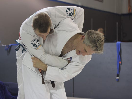 Four-time world champion Stan Mabry tosses instructor Eron Johnsey during a training at Brentwood Jiu Jitsu.