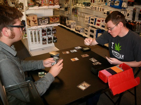 Houston Winslow, 16, goes up against Jared Simpson, 24, who eventually won the EDH title at the Sept. 29 tournament at Silverton Radio Shack.