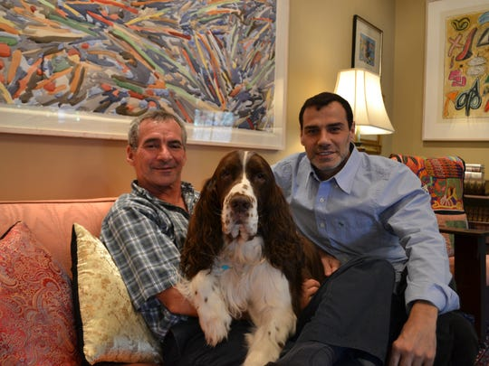 L. Havard Scott, 61, Sergio March-Prieto, 45, and their dog, Happy, at their Shreveport home.