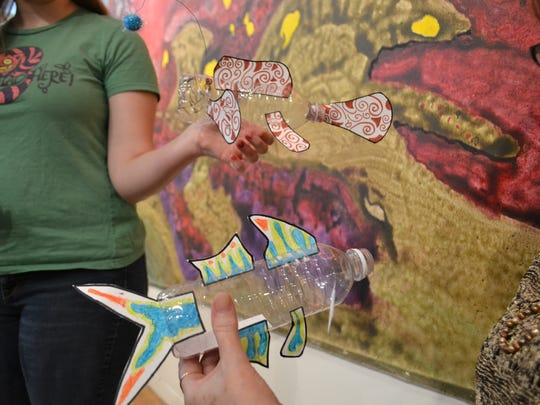 The finished paper-and-plastic fish will be displayed at the Rainforest Art Foundation in the fall.