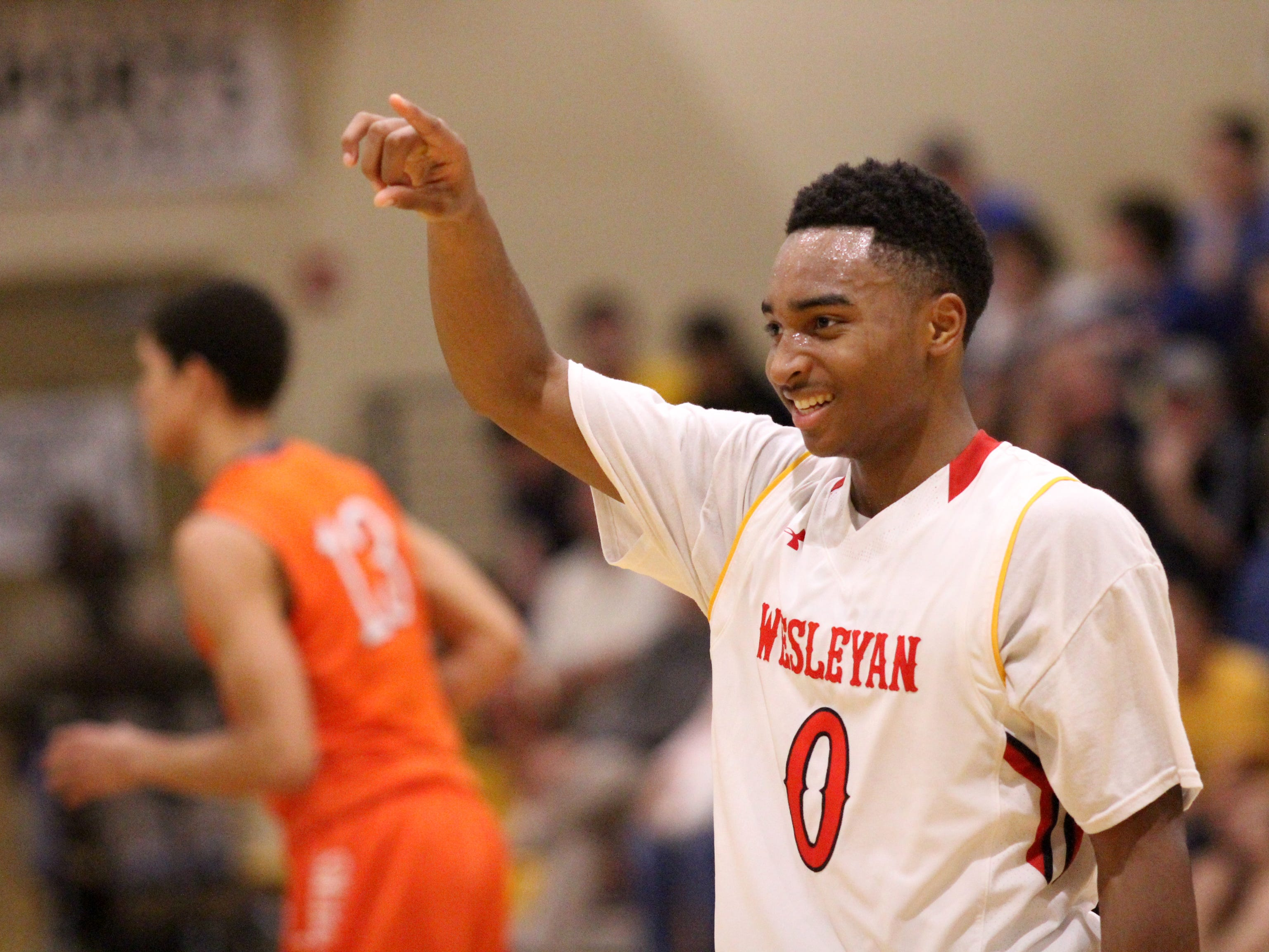 Wesley Christian Academy junior Brandon Childress smiles and points to the crowd after shooting a 3-pointer during a game in the 2014 City of Palms Classic in Fort Myers, Florida.