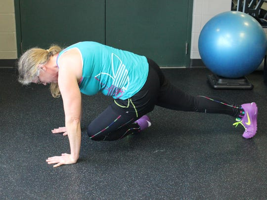 Tuck one let in to the same side elbow so that the knee is bent and front of leg is pointed to side behind the arms.