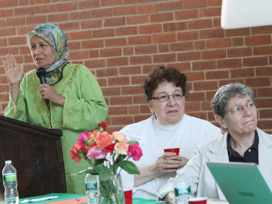 Dr. Mahjabeen Hassan, left, makes a visual presentation as the Rev. Carole Johannsen, coordinator of pastoral care at Phelps Memorial Hospital Center, center, and Rabbi Carla Freedman with the Jewish Family Congregation in South Salem listen during the American Muslim Women's Association's interfaith luncheon at the YWCA in White Plains in 2011.