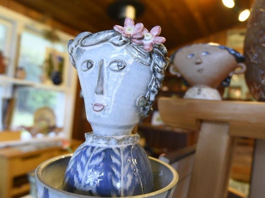 """Jeanne Aurelius' signature """"lady vases"""" are among the pottery pieces created by her and her husband, David Aurelius, at Clay Bay Pottery Gallery in Ellison Bay, one of the host sites in this year's Fall Art Crawl."""