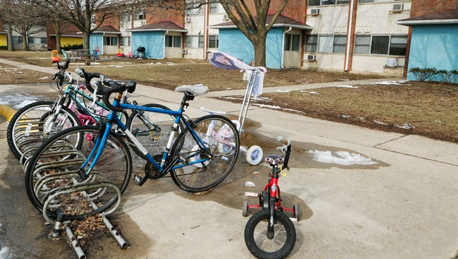 Bicycles, including several children's models, fill the racks Thursday, February 18, 2016, in Purdue Village.