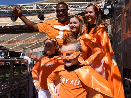 Sterling Henton poses Conner Hill, 6, and his family before the UT Orange and White Spring Game Saturday, April 16, 2016.