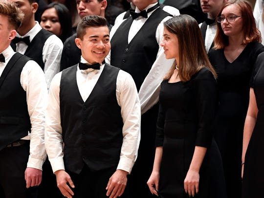 A member of the North Naples Mixed Chorus smiles as the students conclude their performance at Carnegie Hall in New York City on Monday, April 9, 2018.