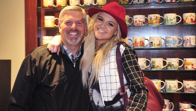 Gordon Kerr, CEO of Black River Entertainment, poses with artist Kelsea Ballerini at Black River Entertainment in Nashville, Tennessee.